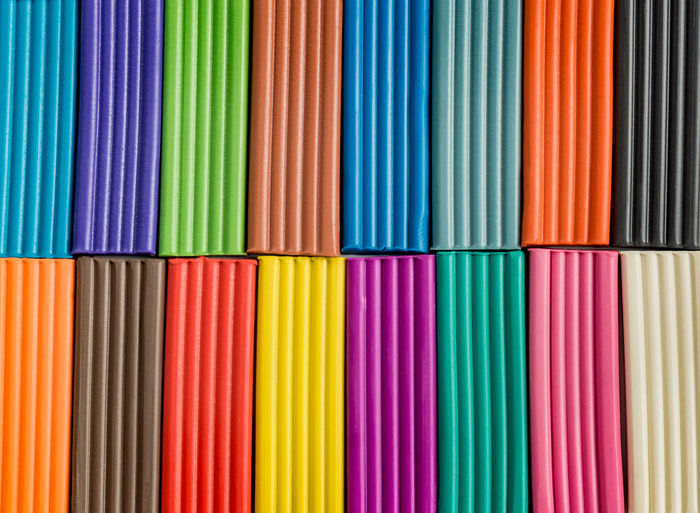 Rainbow colors of modeling clay. multicolored plasticine bars background.