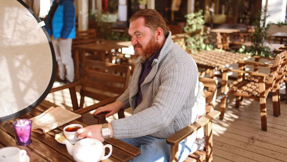 One Person Table Casual Clothing Adult Sitting Food And Drink Side View Indoors  Facial Hair Beard Men Seat Business Mid Adult Wood - Material Chair Lifestyles Cafe Hairstyle