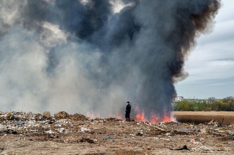 People on smoke emitting from land