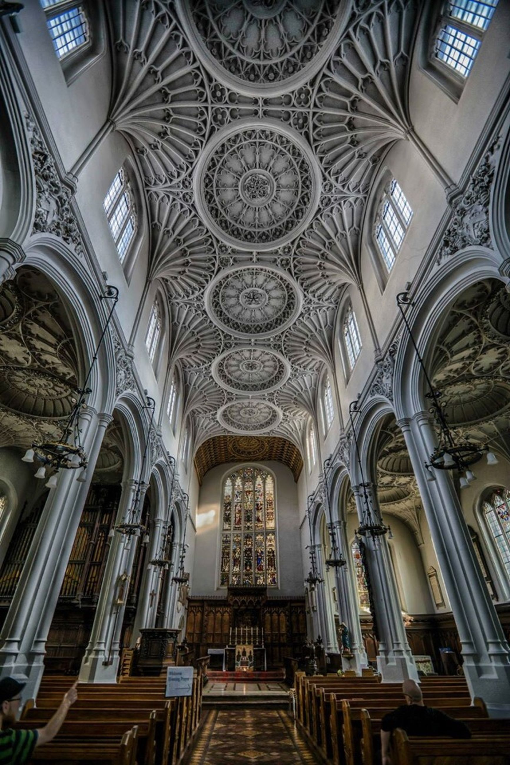 architecture, built structure, indoors, arch, low angle view, ceiling, window, place of worship, religion, church, building exterior, architectural feature, spirituality, ornate, interior, cathedral, design, pattern, building