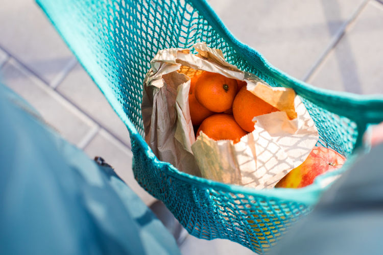High angle view of oranges in bag