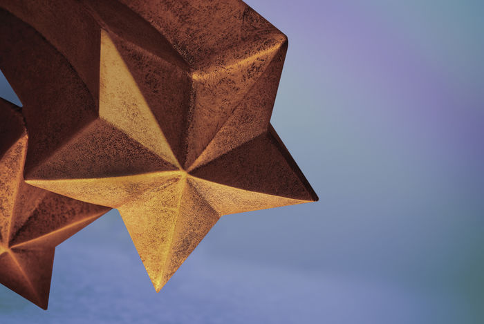 Rising shooting star, gold or bronze colored material, with copy space. Can be used to convey achievement, celebration,an award, or a citation AWARD Achievement Bronze Celebration Copy Space Determination Individuality Standing Out From The Crowd Trophy Vitality Winning Aspiration Celebration Event Comet Decoration Gold Colored No People Positive Emotion Pride Shooting Star Star Star Shape Star Shaped Success Three Dimensional