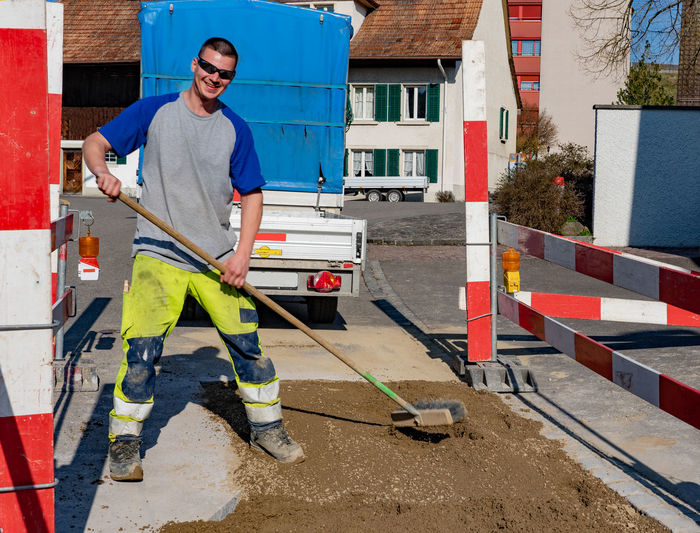 Portrait of smiling worker working at road
