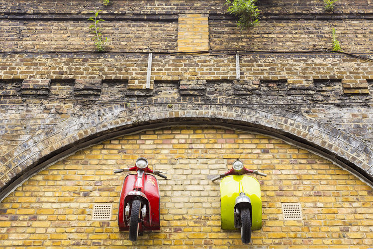 Scooterworks UK on Enid Street, London, England, United Kingdom Arch Architecture Brick Wall Building Exterior Built Structure Day History No People Outdoors Yellow