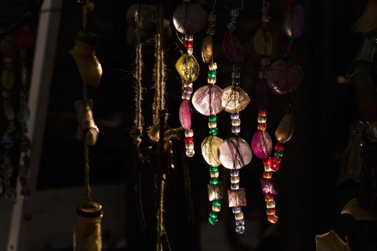 Close-up of illuminated lanterns hanging at store