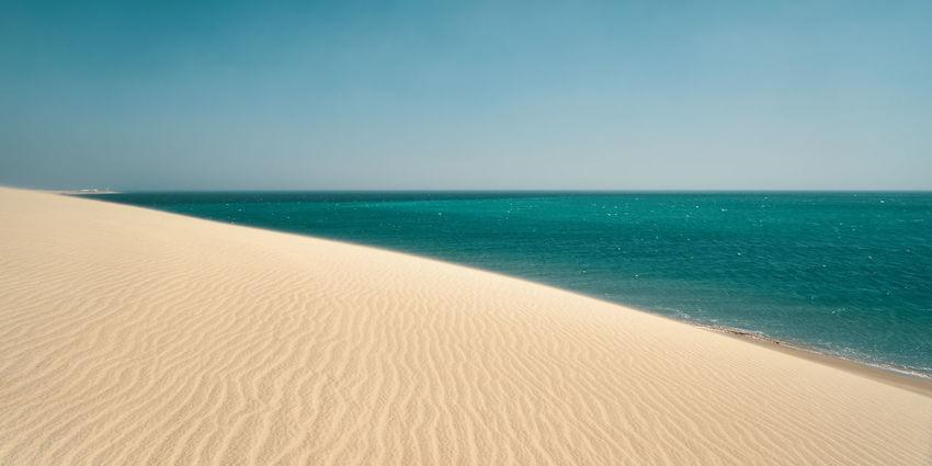 Khor Al Udeid, South of Doha, Qatar. Dunes Khor Al Udeid Beach Copy Space Day Horizon Horizon Over Water Land No People Outdoors Qatar Scenics - Nature Sea Seascape Sky Turquoise Colored Water