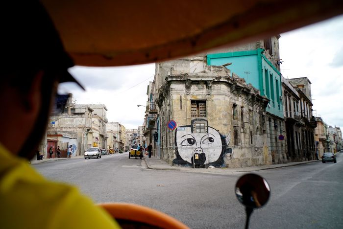 "We ""done that"" by take the Coco taxi for a day tour in Havana. Coco Taxi Cuba Done That. Havana Architecture Building Exterior Built Structure City Day Mammal Men One Person Outdoors People Real People Rear View Road Sky Street Women Done That."