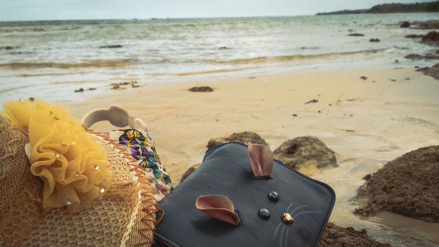 Bag and hats at beach