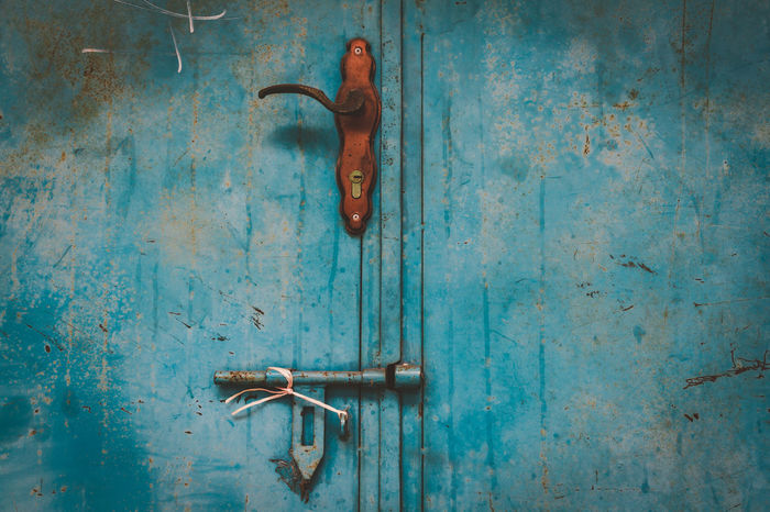 Weathered blue metal door at Haji Lane, Singapore Rust Backgrounds Blue Close-up Closed Door Entrance Handle Indoors  Latch Lock Metal Metal - Material No People Old Protection Rusty Rusty Metal Safety Scratched Security Textured  Textured Effect Vintage Weathered