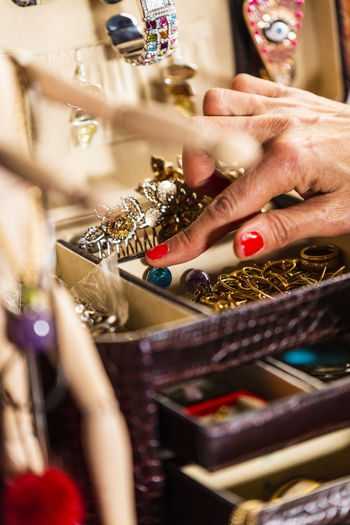 Spreading out the jewelery box Pearls Human Hand Hand Human Body Part One Person Selective Focus Adult Jewelry Indoors  Women Ring Art And Craft Body Part Fashion Close-up Large Group Of Objects Skill  Midsection Real People Table Nail Pearl Jewelry Finger