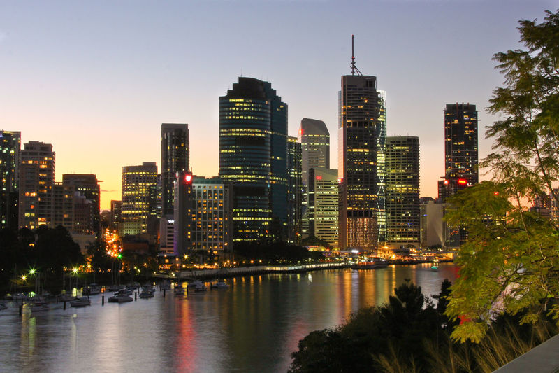 Brisbane skyline at sunset, shot from Kangaroo's point. Brisbane Brisbane River Cruise, Australia Architecture Brisbane River Building Exterior Built Structure City City Life Cityscape Clear Sky Downtown District Growth Illuminated Modern Night No People Outdoors Queensland Sky Skyscraper Sunset Travel Destinations Tree Urban Skyline