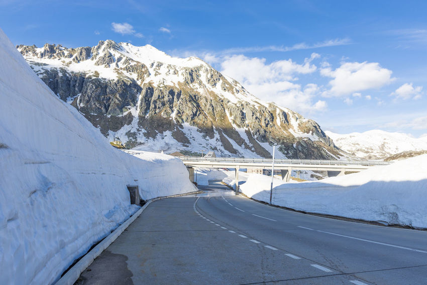 Mountain Road in San Bernardino in Switzerland. Nature Road Snow-capped Sunny Tranquility Wall Abundance Beauty In Nature Blue Sky Cloud - Sky Day Diminishing Perspective Mountain Mountain Range Mountain Road Outdoors Snow Snow Wall Streetphotography Swiss Alps The Way Forward