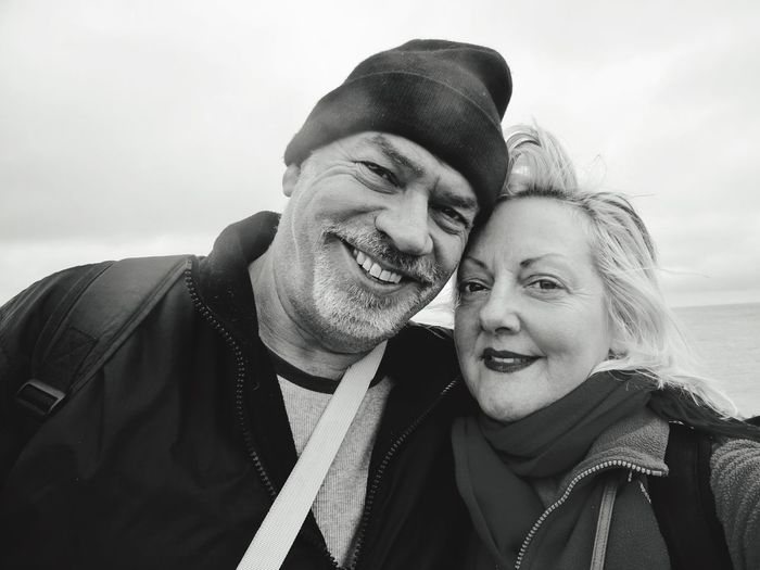 Portrait of smiling mature man embracing woman