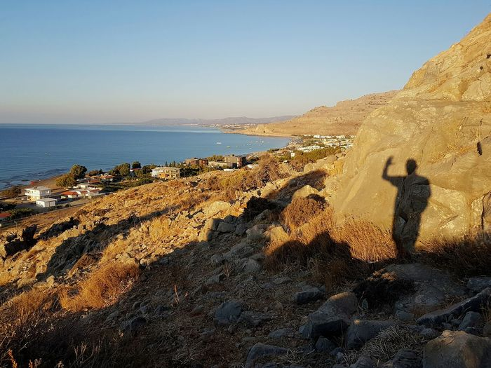 Hi From Pefkos Just A Shadow Of Myself Horizon Over Water Shore Vacations Clear Sky Beauty In Nature Hiking Adventures Rhodes Greek Islands