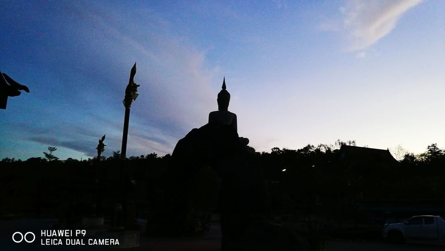 Silhouette of statues at sunset