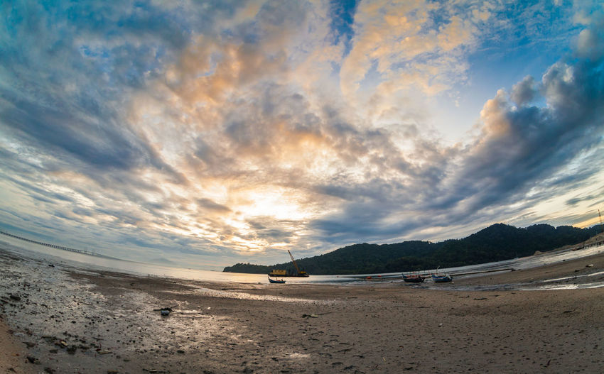 Mud texture with landscape view for background Sky Nature Water Scenics - Nature Tranquil Scene Cloud - Sky Tranquility Beauty In Nature Land Beach Sea Sand Fish-eye Lens Non-urban Scene Sunset Outdoors No People Environment Idyllic