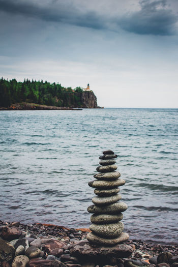 Beach Beauty In Nature Cloud - Sky Day Great Views Horizon Over Water Light Lighthouse Nature No People Outdoors Pebble Road Rock - Object Scenics Sky Stack Tranquil Scene Tranquility Water