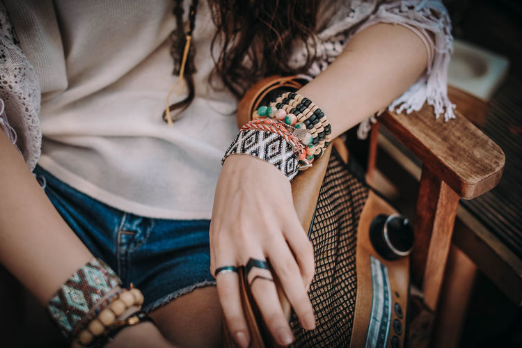 Female hands with boho accessories bracelets made of colored beads