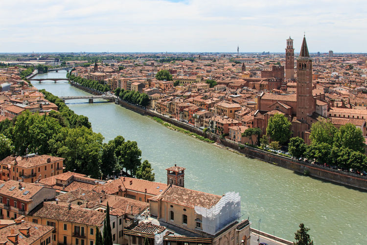 Verona skyline with Adige river at noon. Sant' Anastasia Church and Torre dei Lamberti (Lamberti Tower) also visible. Architecture Arena Bridge - Man Made Structure Building Exterior Built Structure City City City Life Cityscape Cloud - Sky Coluseum Connection Crowded Day Engineering High Angle View Italy Residential Building Residential District River Romeo And Juliet Sky Travel Destinations Verona Water