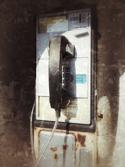 Old style communication Abandoned Bad Condition Close Up Coin Operated Communication Convenience Deterioration Dirty Equipment Obsolete Old-fashioned Red Retro Styled Street Technology Telephone Text Wall Wall - Building Feature Western Script