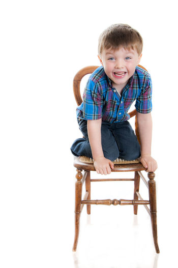 Casual Clothing Childhood Cute Front View Happy Boy Happy Child  Kneeling In A Chair Leisure Activity Lifestyles Portrait Relaxation Smiling Face Studio Shot The Portraitist - 2015 EyeEm Awards White Background