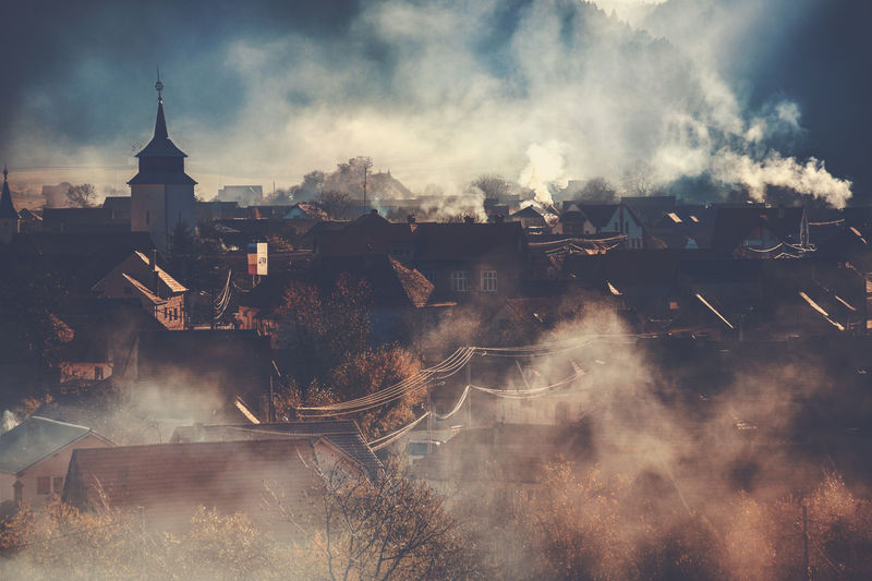 Early morning in a small rural town. Architecture Built Structure Building Exterior Building Smoke - Physical Structure Nature Smoke Cloud - Sky Sky Outdoors City High Angle View No People Environment Roof Cityscape Morning Transylvania Romania Brasov Zarnesti Visitromania