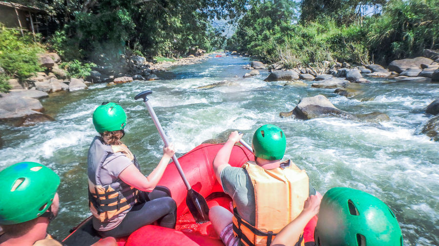 white water rafting with a team of helmets in Thailand Chiang Mai | Thailand RaftingTrip Risky Teamwork Thailand Adventure Boat Day Helmets Nature Outdoors People Rafting Rafting!! River Rock - Object Rocks And Water Teamwork Tourism Water