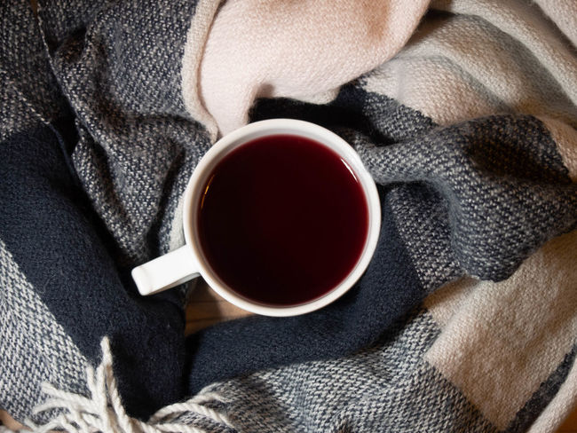 Drink Refreshment Food And Drink Cup Mug Tea Hot Drink Coffee Coffee - Drink Tea - Hot Drink Indoors  Close-up Sweater Tea Cup Relaxation Coffee Cup Warm Clothing Freshness Clothing Drinking Black Tea Scarf