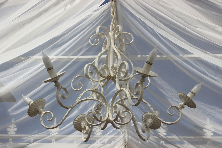 Architectural Feature Chandelier Close-up Curtain Day Decor Decoration Design Directly Below History Lamp Lighting Equipment Low Angle View Metal Work Modern White White Background White Color
