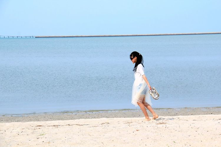 Side View Of Girl Walking At Beach