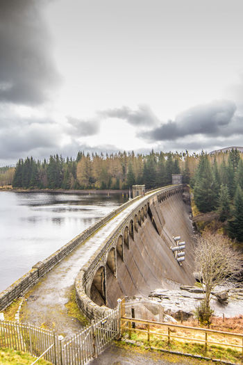 Architecture Beauty In Nature Bridge - Man Made Structure Built Structure Cloud - Sky Connection Dam Day Hydroelectric Power Nature No People Outdoors River Sky Tree Water