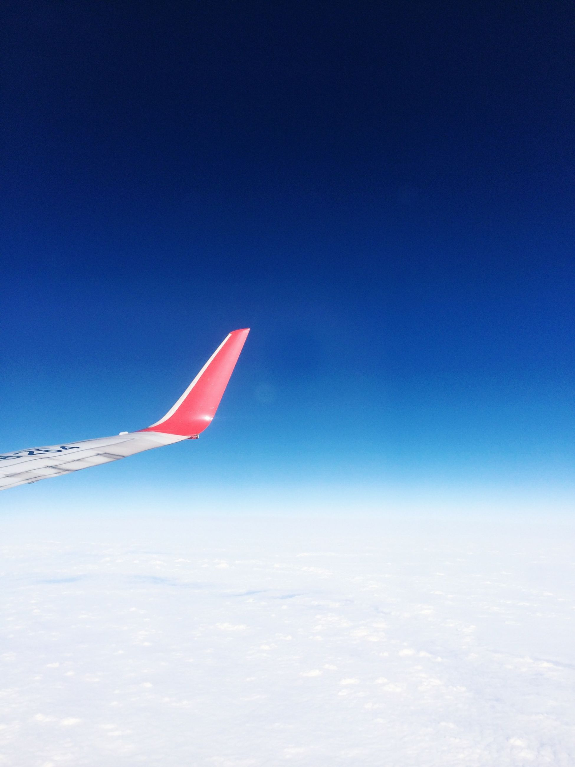 transportation, flying, air vehicle, airplane, blue, mode of transport, aircraft wing, copy space, clear sky, mid-air, travel, part of, journey, sky, on the move, cropped, nature, outdoors, no people, beauty in nature