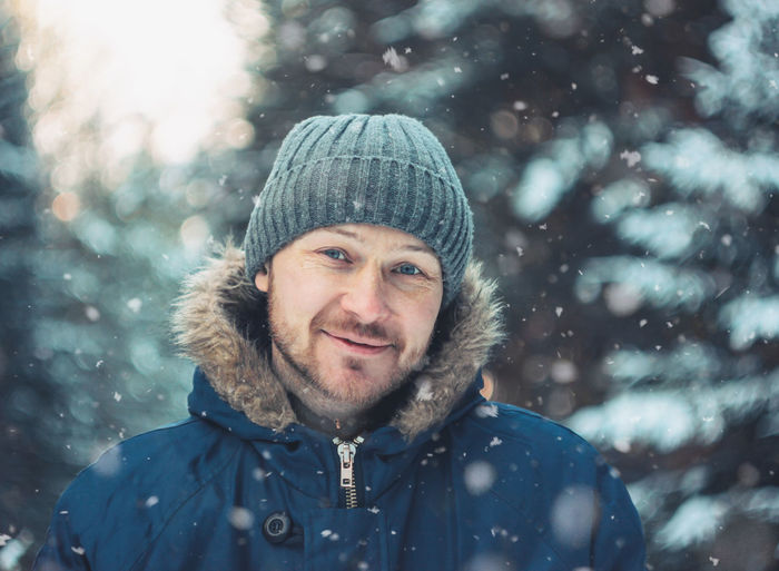 Portrait of smiling man in snow