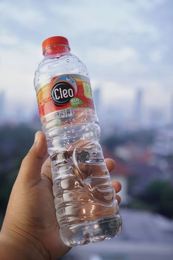 Close-up of hand holding bottle