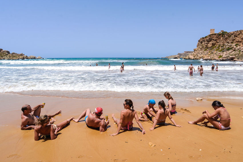 Malta Sand Beach Summertime Travel Adult Beach Beauty In Nature Clear Sky Day Golden Bay Horizon Over Water Large Group Of People Lifestyles Men Nature Outdoors People Real People Sand Scenics Sea Shore Sky Summer Travel Destinations Turism Vacations Water Wave