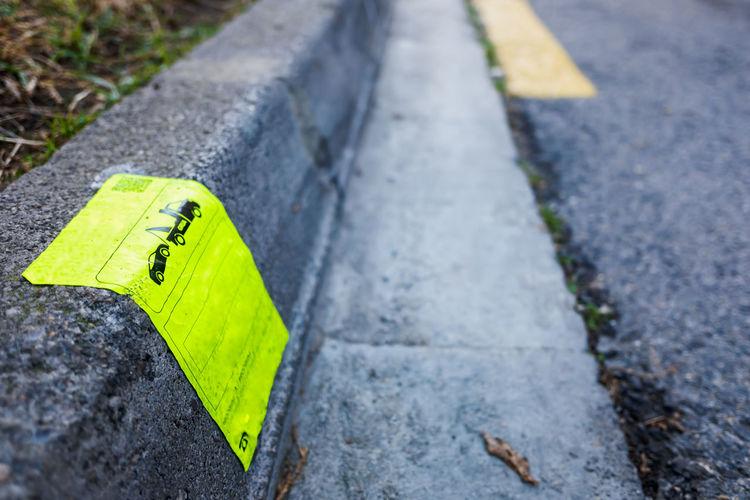 Close-up of yellow arrow symbol on road