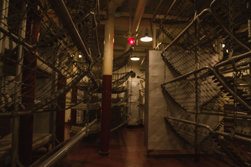 Sleeping Quarters USS North Carolina Military Beds Sleeping Quarters USS North Carolina Battleship Indoors  Illuminated Staircase Steps And Staircases Architecture No People Built Structure