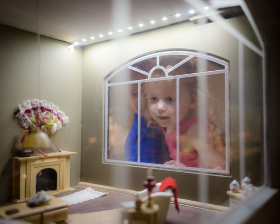Child Childhood Females Front View Girls Glass - Material Home Interior Illuminated Indoors  Innocence Leisure Activity Lifestyles Lighting Equipment One Person Portrait Real People Reflection Transparent Women This Is Family