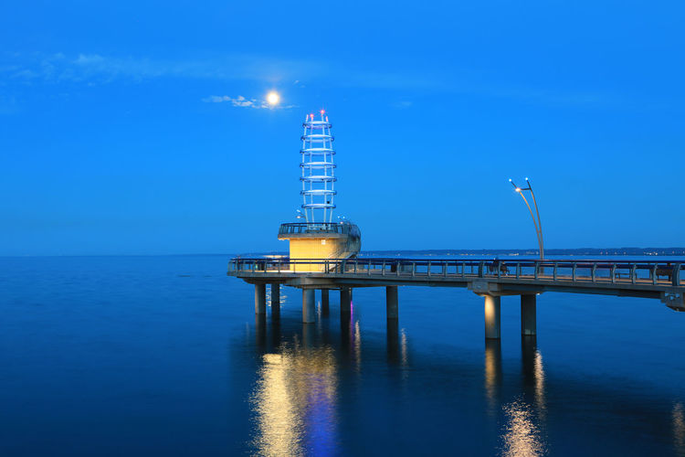 Brant St. Pier Burlington, Canada at night Pier Architecture Blue Bridge - Man Made Structure Building Exterior Built Structure City Clear Sky Horizon Over Water Illuminated Moon Nature Night Outdoors Sea Sky Travel Destinations Water