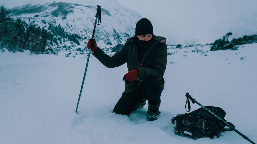 Full length of man holding ice on mountain