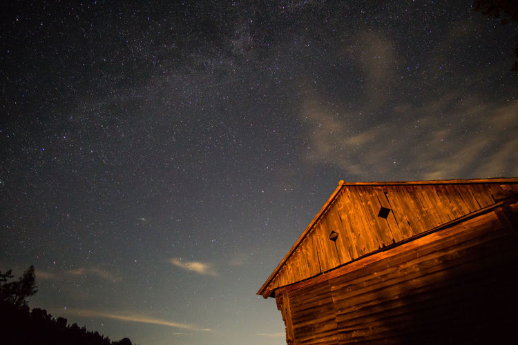 Low angle view of hut against sky at night