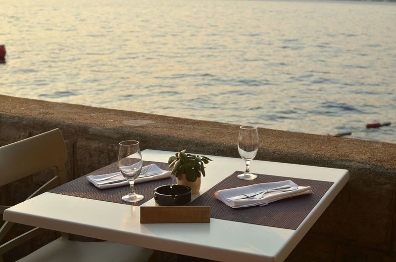 Set table of a restaurant with a sea view