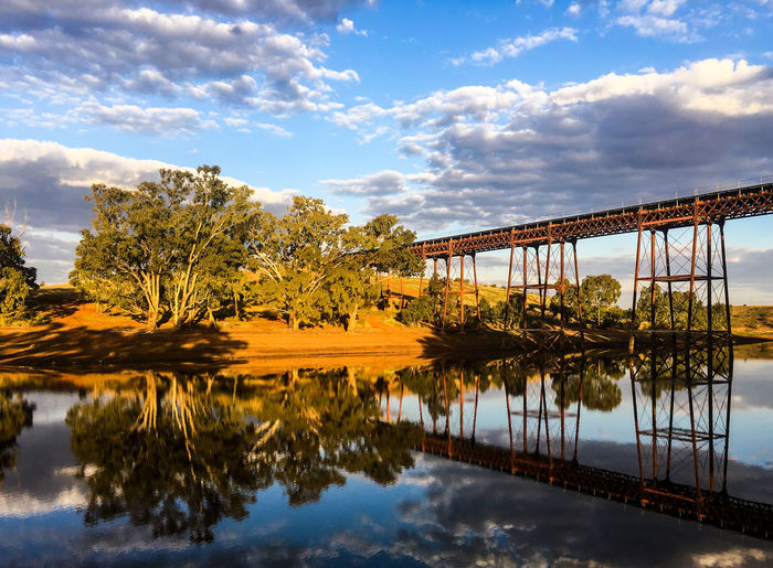 Rail road bridge above the Melton Reservoir Morning Reflection S Tree Architecture Beauty In Nature Bridge Cloud - Sky Day Evening Forest Lake Melton Nature No People Outdoors Rail Reflection Reservoir Sky Tree Water Wood - Material