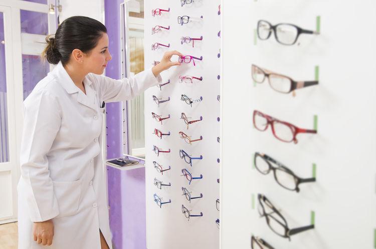 Optometrist store young optician 30 Years Old Doctor  Eye Test Pharmacy Spanish Woman Work Eye Eye Test Equipment Lab Lenses Optician Opticians Optometrist Optometry Shop Store Test Vision Women