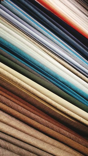 Full frame shot of colorful fabrics for sale at shop