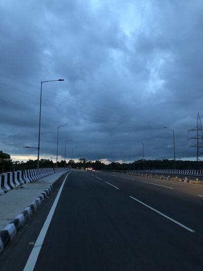Highway by street against sky