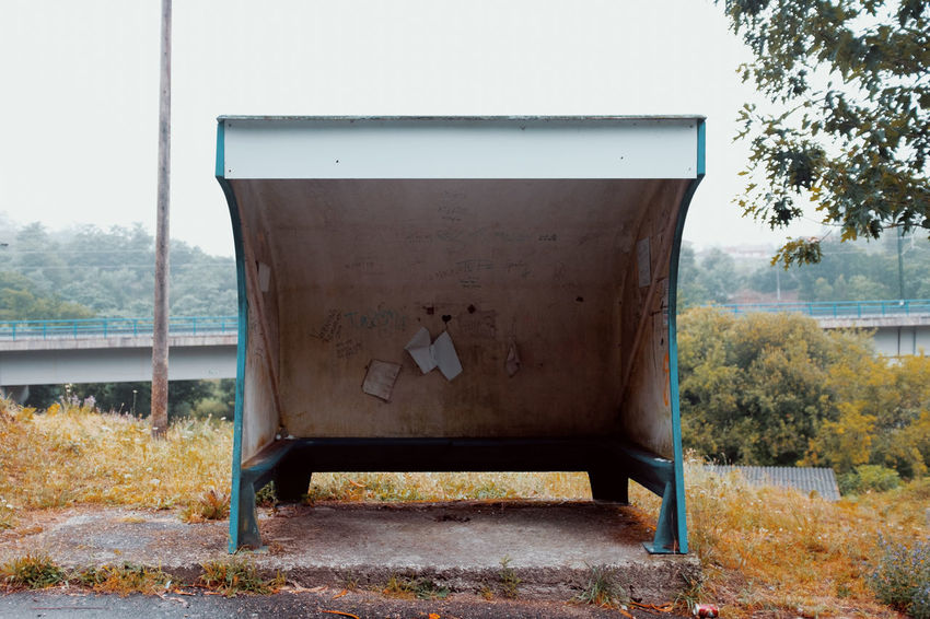 LOST IN GALICIA 🚌 Lostingalicia Tree Nature Day Plant No People Outdoors Abandoned Old Bus Stop Threeweeksgalicia Land Field Metal Sky Rusty Transportation Wood - Material Empty Clear Sky Grass Obsolete Seat
