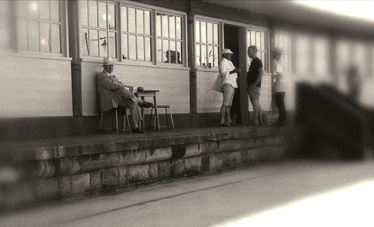 Passing the time of day People Railroad Station Adults Only Real People Men British Summertime Waiting For Someone Watching The World Go By Passing The Time Peoplephotography People Are People Person Sitting Alone Man Alone Blackandwhitephotography