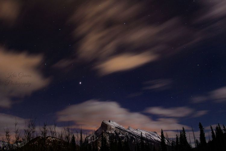 Low Angle View Of Mountains Against Sky At Night
