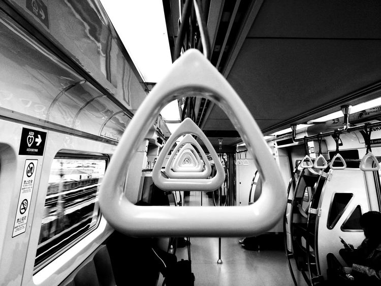 Triangles in the Square city An Eye For Travel Transportation Mode Of Transport Public Transportation Vehicle Interior Train - Vehicle Rail Transportation Travel Indoors  Subway Train Journey Land Vehicle Vehicle Seat Commuter Train Day No People